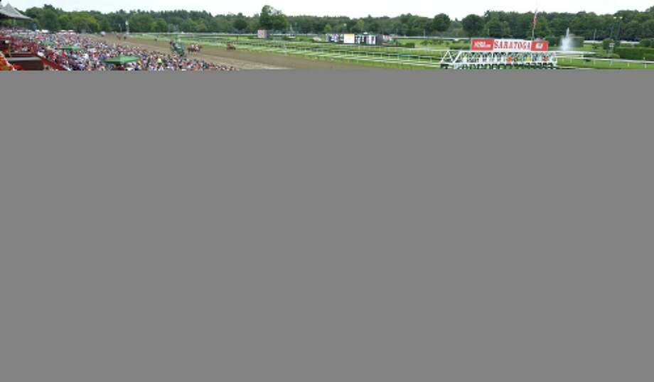 A large crowd is on hand for the Alabama Stakes at Saratoga Race Course Saturday afternoon Aug. 16, 2014, in Saratoga Springs, N.Y.  (Skip Dickstein/Times Union) Photo: SKIP DICKSTEIN