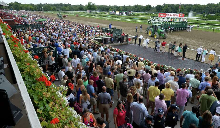 A large crowd is on hand for the Alabama Stakes at Saratoga Race Course Saturday afternoon Aug. 16,