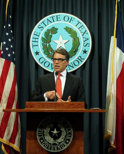 Texas Gov. Rick Perry speaks during a news conference on Saturday, Aug. 16, 2014, in Austin, Texas.