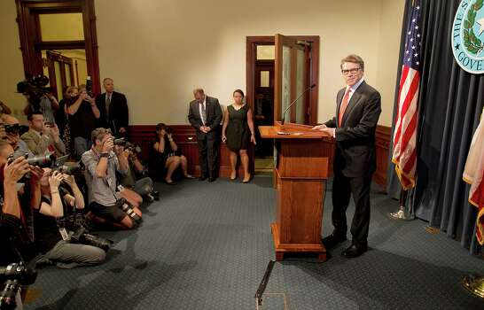 Gov. Rick Perry makes a statement in Austin, Texas on Saturday, Aug. 16, 2014 concerning the indictment on charges of coercion of a public servant and abuse of his official capacity. Perry is the first Texas governor since 1917 to be indicted. Photo: Laura Skelding, Associated Press / Austin American-Statesman