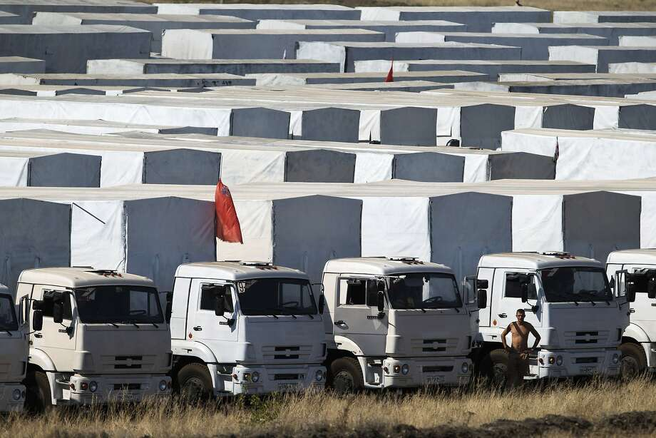 A Russian humanitarian aid convoy waits 17 miles from the Ukrainian border until all sides agree to guarantee its security. Photo: Pavel Golovkin, Associated Press