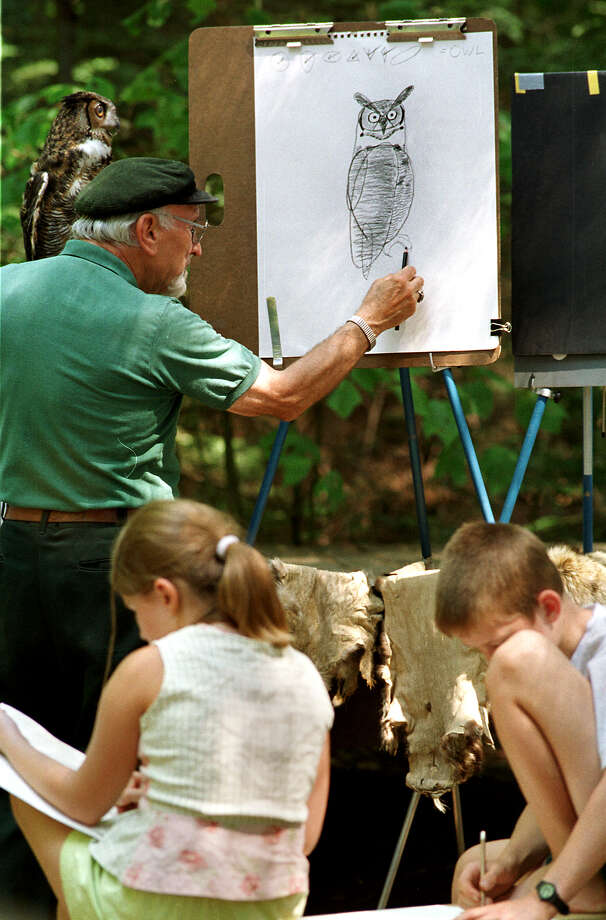 Times Union Staff Photo by Jonathan Fickies -- Wildlife artist Wayne Trimm describes to day campers the figure of a perched owl, while providing a live model, Thursday, August 9, 2001 at Dyken Pond. Photo: JONATHAN FICKIES / ALBANY TIMES UNION