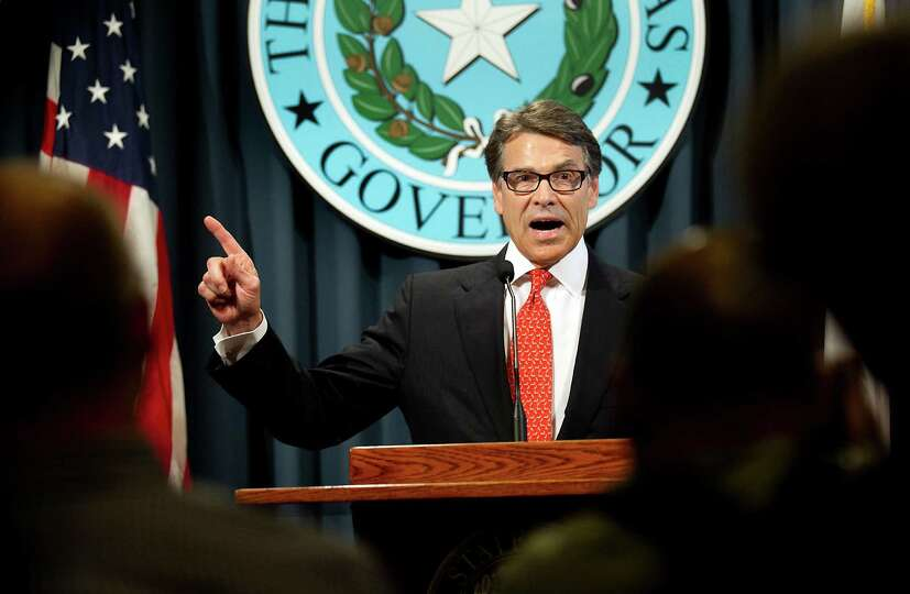 2400 x 1569~~$~~Gov. Rick Perry makes a statement in Austin, Texas on Saturday, Aug. 16, 2014 concer