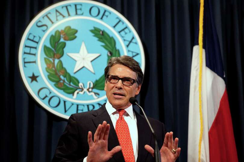 Gov. Rick Perry makes a statement at the capitol building in Austin, Texas on Saturday, Aug. 16, 201