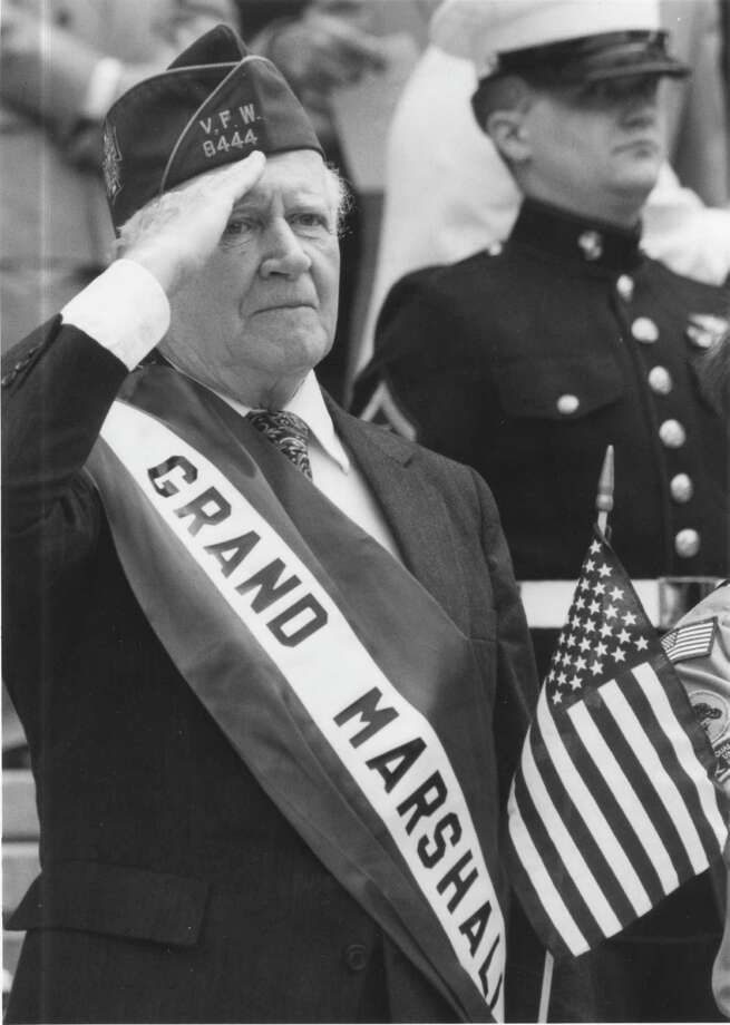 Raymond F. Joyce Jr. salutes from the reviewing stand in front of the state Education Department after serving as grand marshal of Albany's 1993 Memorial Day parade. (Times Union Archive)