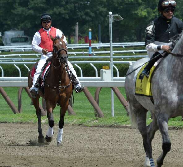 Head outrider Miguel Gutierrez works the main track Thursday, Aug. 7, 2014, at Saratoga Race Course