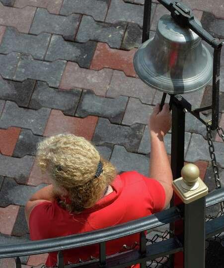 Bell ringer Jennifer Carlone rings the bell in the winner's circle Thursday, Aug. 7, 2014, at Sarato