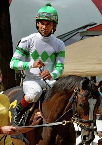 Jockey Shaun Bridgmohan prepare for a race Thursday, Aug. 7, 2014, at Saratoga Race Course in Saratoga Springs, N.Y. (Skip Dickstein/Times Union) Photo: SKIP DICKSTEIN