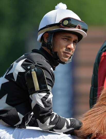 Jockey Shaun Bridgmohan prepare for a race Thursday, Aug. 7, 2014, at Saratoga Race Course in Sarato