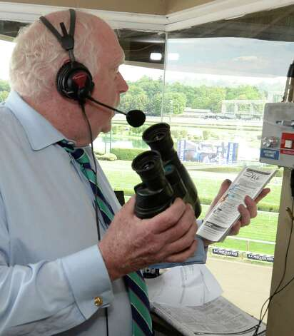Retiring track announcer Tom Durkin prepares for a race Thursday, Aug. 7, 2014, at Saratoga Race Course in Saratoga Springs, N.Y. (Skip Dickstein/Times Union) Photo: SKIP DICKSTEIN