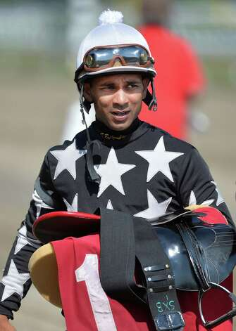 Jockey Shaun Bridgmohan heads for the scales after a race at  Saratoga Race Course Thursday, Aug. 7, 2014, in Saratoga Springs, N.Y. (Skip Dickstein/Times Union) Photo: SKIP DICKSTEIN