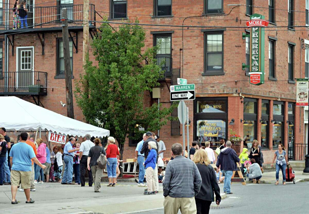 Crowds arrive for Perreca's Bakery's 100th Birthday Block Party Saturday August 16, 2014, in Schenectady, NY. (John Carl D'Annibale / Times Union)