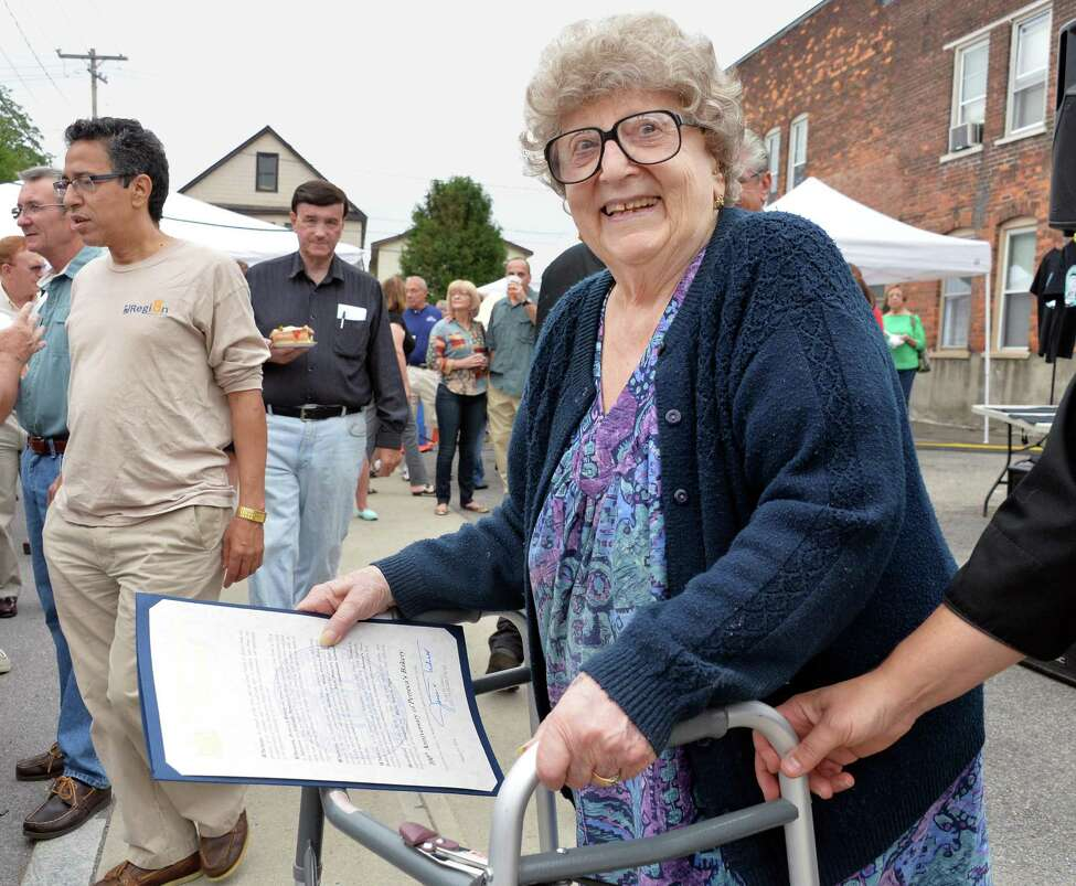 Lilia Perreca Papa, 89, who's parents founded the business, during Perreca's Bakery's 100th Birthday Block Party Saturday August 16, 2014, in Schenectady, NY. (John Carl D'Annibale / Times Union)