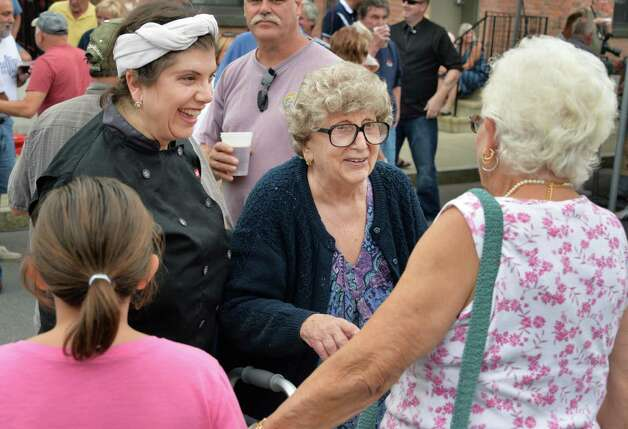 Lilia Perreca Papa, center, 89, who's parents founded the business, and her daughter Maria Perreca Papa, left, meet well wishers and long-time customers during Perreca's Bakery's 100th Birthday Block Party Saturday August 16, 2014, in Schenectady, NY.   (John Carl D'Annibale / Times Union) Photo: John Carl D'Annibale / 00028170A