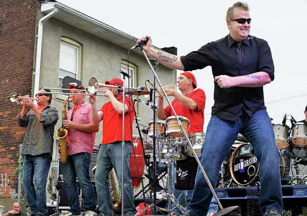 Lead singer Todd Hanhurst, right, and The Refrigerators perform during Perreca's Bakery's 100th Birthday Block Party Saturday August 16, 2014, in Schenectady, NY.   (John Carl D'Annibale / Times Union) Photo: John Carl D'Annibale / 00028170A