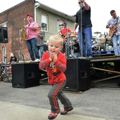 Three-year-old Richard Mourer of Schenectady dances as  The Refrigerators perform during Perreca's Bakery's 100th Birthday Block Party Saturday August 16, 2014, in Schenectady, NY.   (John Carl D'Annibale / Times Union) Photo: John Carl D'Annibale / 00028170A