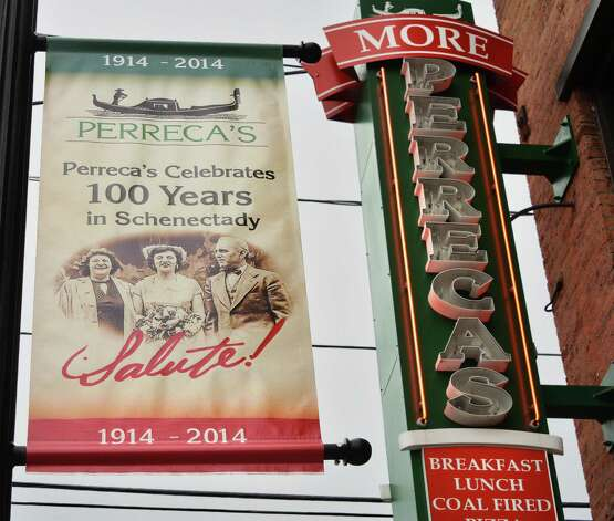 Signs outside Perreca's Bakery's as it celebrates its100th Birthday with a Block Party Saturday August 16, 2014, in Schenectady, NY.   (John Carl D'Annibale / Times Union) Photo: John Carl D'Annibale / 00028170A