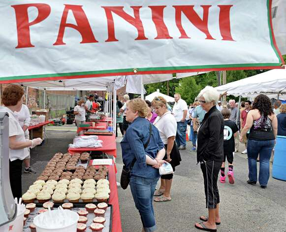 Patrons line up during Perreca's Bakery's 100th Birthday Block Party Saturday August 16, 2014, in Schenectady, NY.   (John Carl D'Annibale / Times Union) Photo: John Carl D'Annibale / 00028170A
