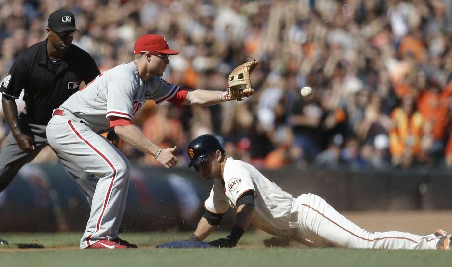 Joe Panik slides into third base with a leadoff triple in the eighth. Moments later, he scored what proved to be the game- winning run on a single to left by Gregor Blanco. Photo: Ben Margot, Associated Press