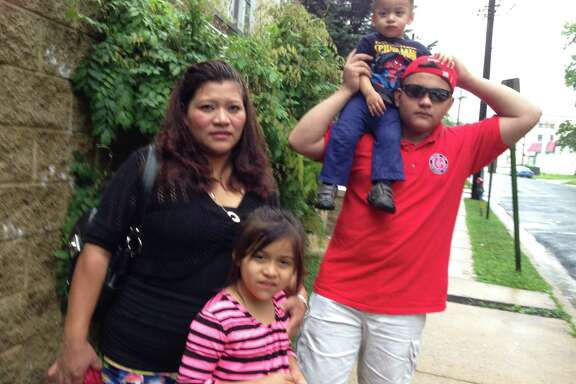 Trinidad and her family Brandon, right; Aury, 6; and Chally, 20 months. Julio the father, is not pictured. Brandon traveled from Guatemala to be with his parents and siblings and now awaits a court hearing on his immigration status.