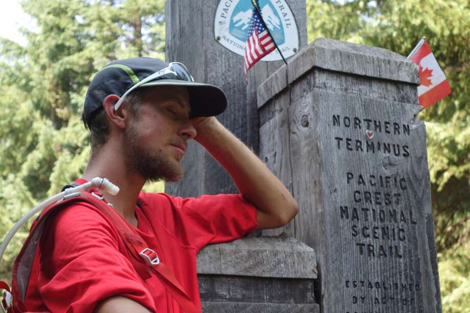 An overwhelming moment: End of the trail at Washington/Canada border -- and a new record Photo: RunForColin.com