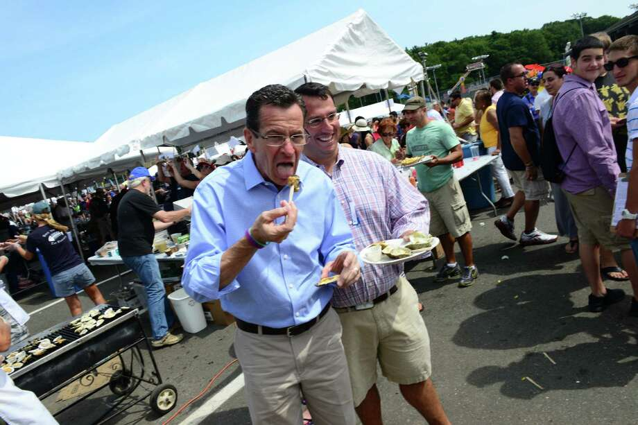 Governor Dannel Malloy and Milford Mayor Ben Blake try some oysters during the 40th Annual Milford Oyster Festival in downtown Milford, Conn. on Saturday, August 16, 2014. Photo: Christian Abraham / Connecticut Post