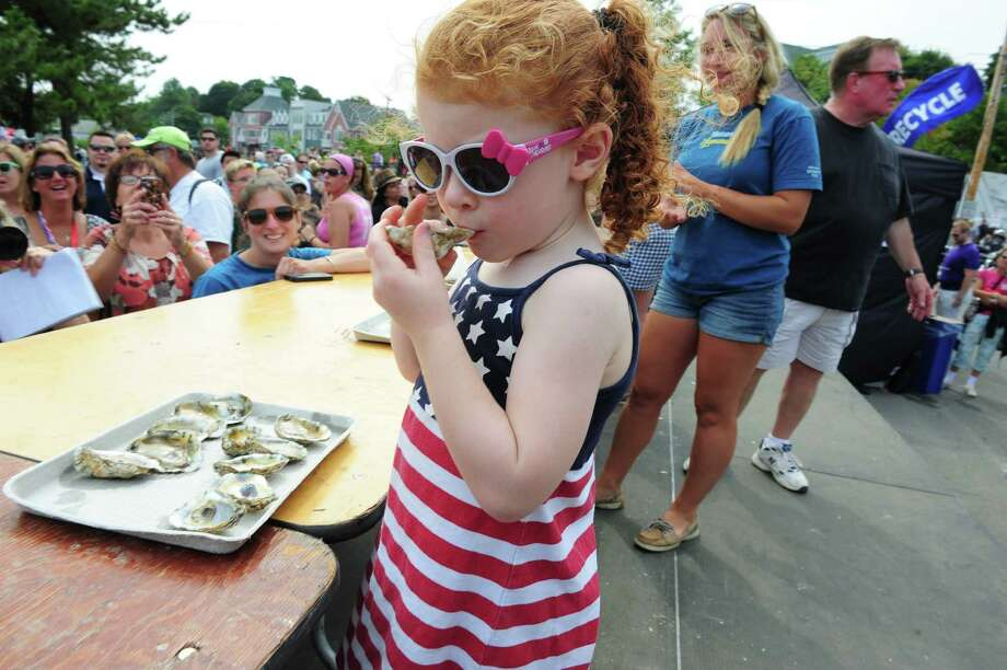 "Last minute entry, Addison ""Moose"" Kozloski, 3, of New Haven, takes part in the oyster eating contest on Oyster Stage during the 40th Annual Milford Oyster Festival in downtown Milford, Conn. on Saturday, August 16, 2014. Photo: Christian Abraham / Connecticut Post"