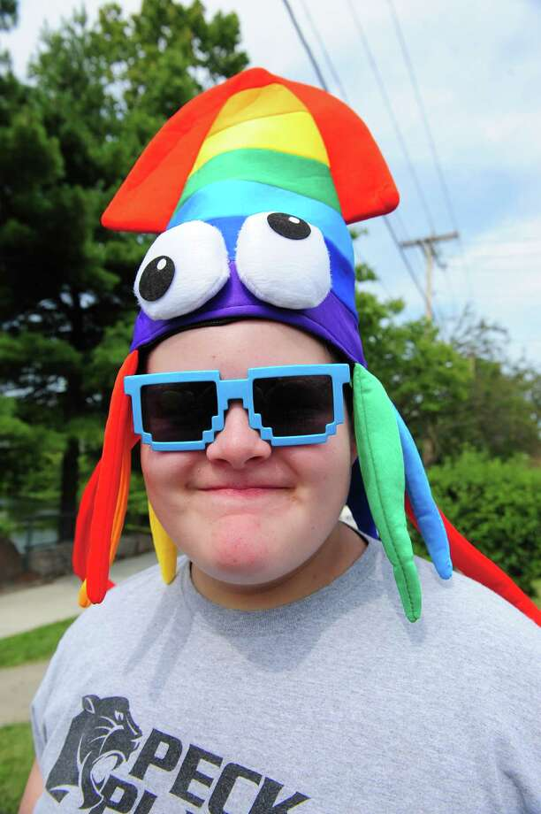 Keith Norton, 13, of Orange, sports a squid hat, during the 40th Annual Milford Oyster Festival in downtown Milford, Conn. on Saturday, August 16, 2014. Photo: Christian Abraham / Connecticut Post
