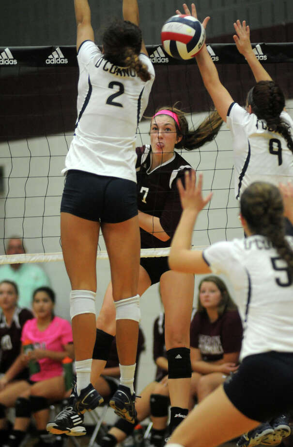 Pearland sophomore outside hitter Brooke Botkin, center, slams a ball between San Antonio O'Connor's Alex Ecker (#2) and Kaitlyn Kluna (#9) during their semifinal game at the 2014 Texas Volleyball Invitational at the Pearland High School Searcy Center on Saturday. Photo: Jerry Baker, For The Chronicle