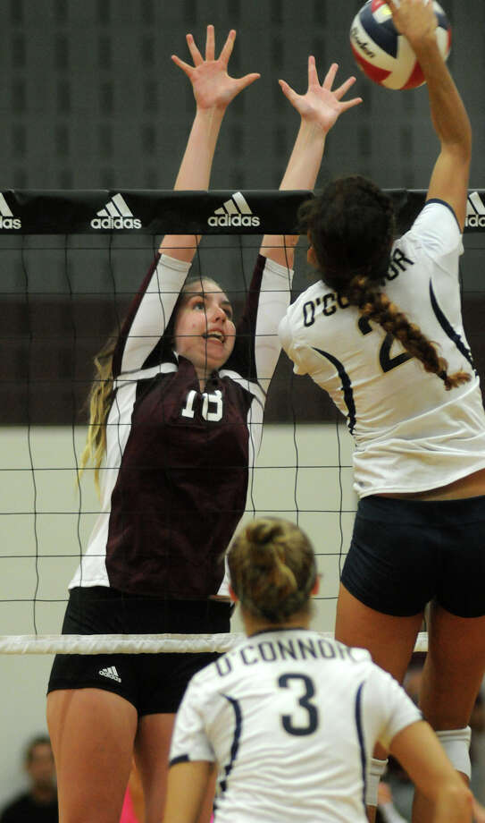 Pearland sophomore middle blocker Samantha Costello, left, works for a block against San Antonio O'Connor's Alex Ecker (#2) during their semifinal game at the 2014 Texas Volleyball Invitational at the Pearland High School Searcy Center on Saturday. Photo: Jerry Baker, For The Chronicle
