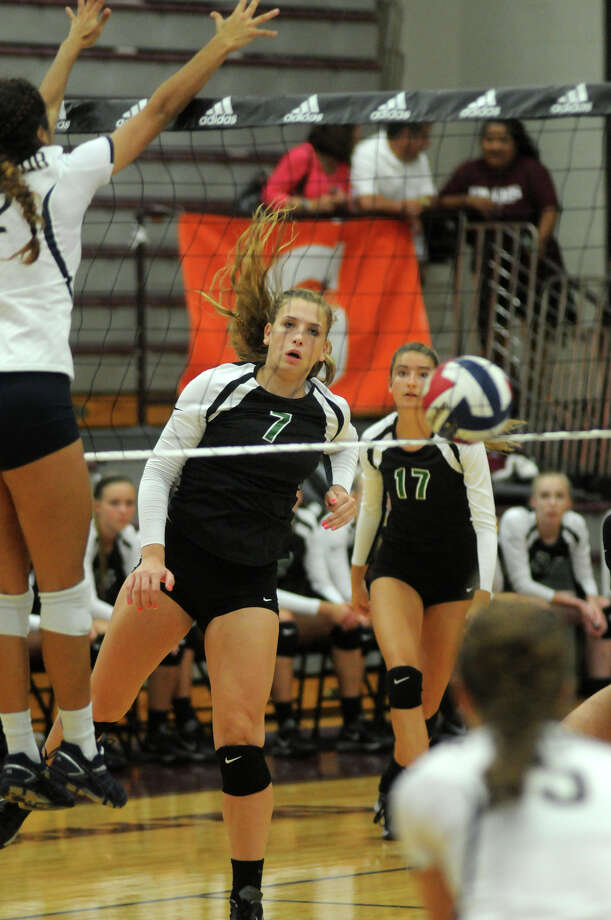 Southlake Carroll senior outside hitter Madison Drescher, center, sends a ball past San Antonio O'Connor senior middle blocker Alex Ecker for a kill during the championship game of the 2014 Texas Volleyball Invitational at the Pearland High School Searcy Center on Saturday. Photo: Jerry Baker, For The Chronicle