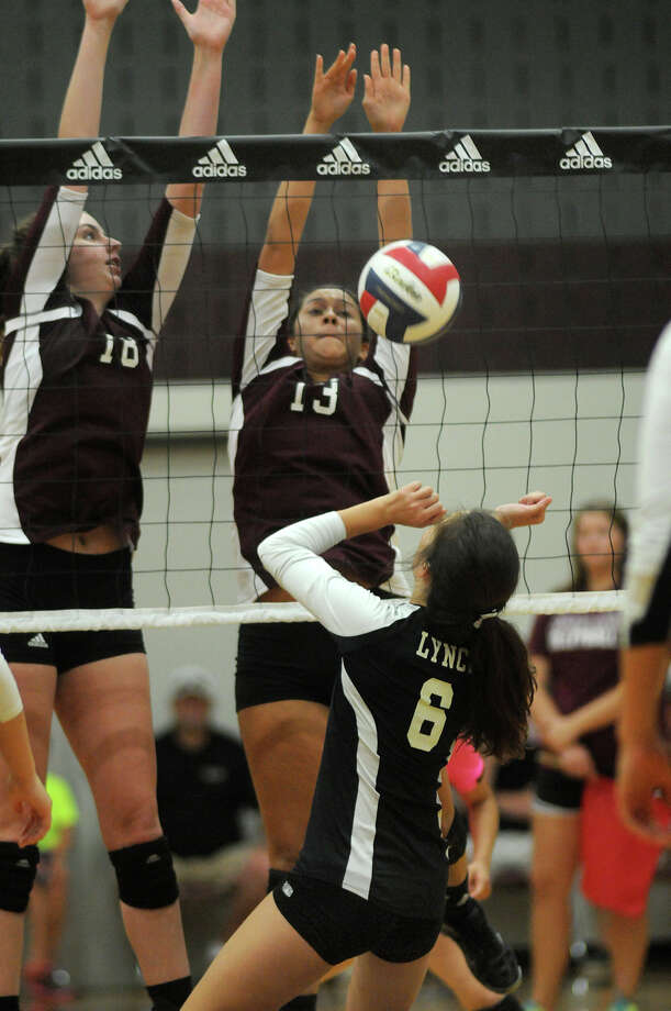 Pearland's senior outside hitter Alex Aguilera, center, and sophomore middle blocker Samantha Costello, left, team up for a block against Bishop Lynch's Callie Williams (#6) during the 3rd place game of the 2014 Texas Volleyball Invitational at the Pearland High School Searcy Center on Saturday. Photo: Jerry Baker, For The Chronicle