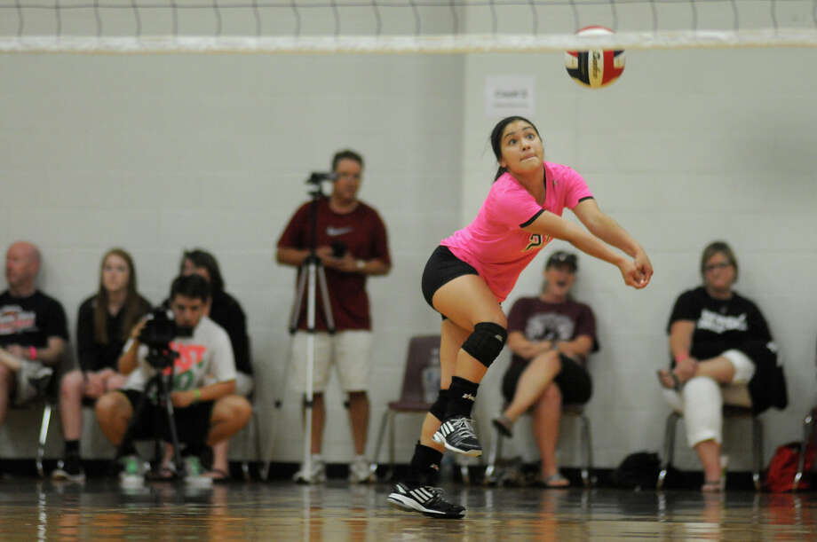 Pearland junior Libero Amanda Chapa makes a play against Bishop Lynch during the 3rd place game of the 2014 Texas Volleyball Invitational at the Pearland High School Searcy Center on Saturday. Photo: Jerry Baker, For The Chronicle