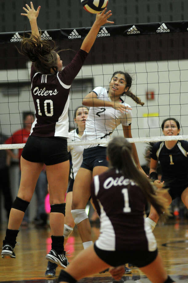 San Antonio O'Connor senior middle blocker Alex Ecker, center, works for a kill against Pearland junior middle blocker Riley Murdock (#10) during their semifinal  game of the 2014 Texas Volleyball Invitational at the Pearland High School Searcy Center on Saturday. Photo: Jerry Baker, For The Chronicle