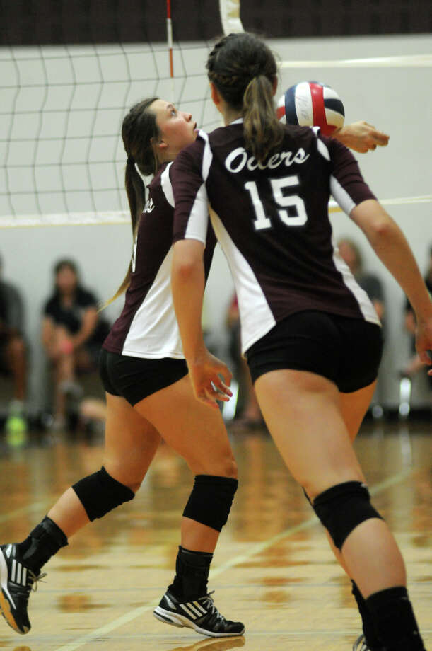 Pearland senior setter Chelsey Watts, left, makes a pass in front of teammate Cassidy Nussman (#15) during their semifinal game against San Antonio O'Connor at the 2014 Texas Volleyball Invitational at the Pearland High School Searcy Center on Saturday. Photo: Jerry Baker, For The Chronicle