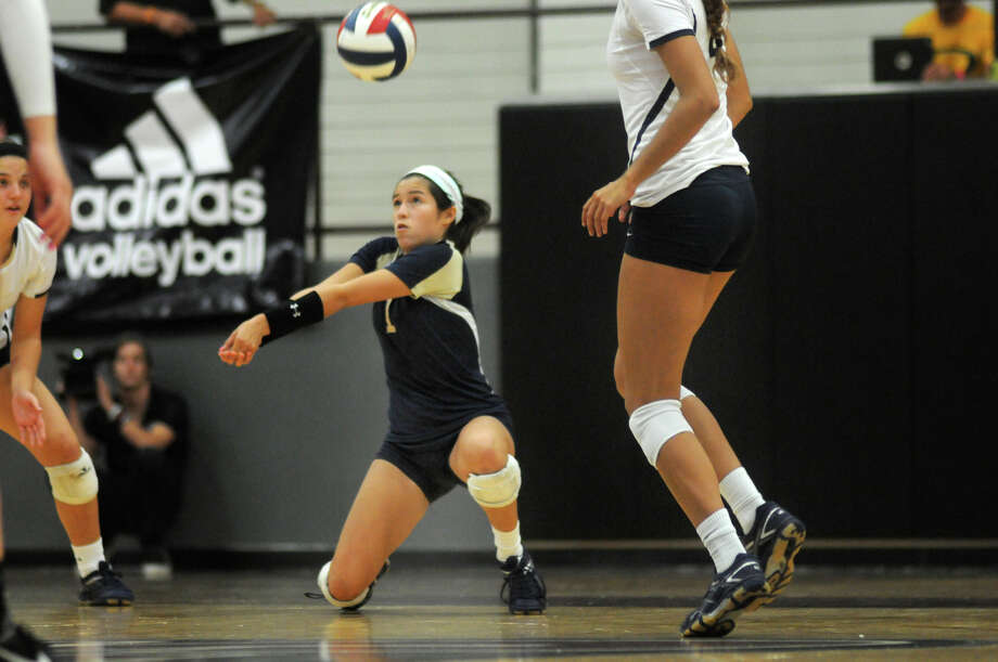San Antonio O'Connor senior defensive specialist Laura Cruz makes a play against Southlake Carroll during the championship game of the 2014 Texas Volleyball Invitational at the Pearland High School Searcy Center on Saturday. Photo: Jerry Baker, For The Chronicle