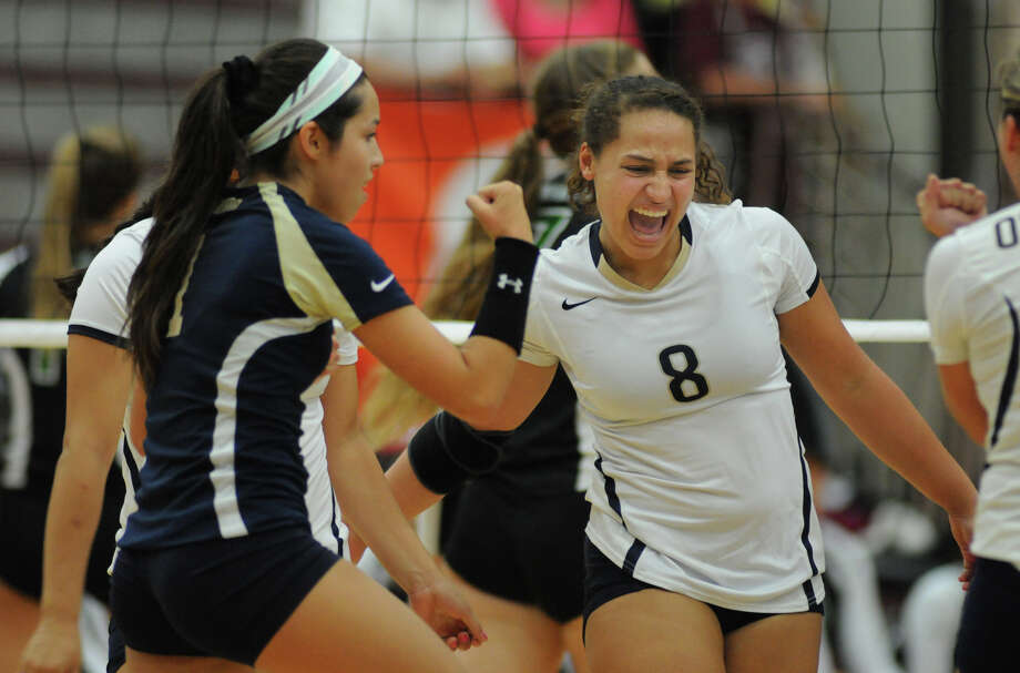 San Antonio O'Connor senior outside hitter Gillianne Simpkins, from right, and senior defensive specialist Laura Cruz celebrate a point against Southlake Carroll during the championship game of the 2014 Texas Volleyball Invitational at the Pearland High School Searcy Center on Saturday. Photo: Jerry Baker, For The Chronicle