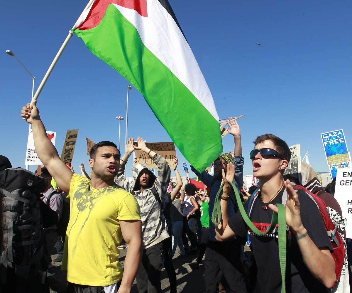 Thousands of pro-Palestinian protesters march to the Port of Oakland to attempt a blockade of the Israeli cargo ship Zim, which was scheduled to dock at the port in Oakland, Calif. on Saturday, Aug. 16, 2014. As of late afternoon, hundreds of police officers were preventing the protesters from entering port property.