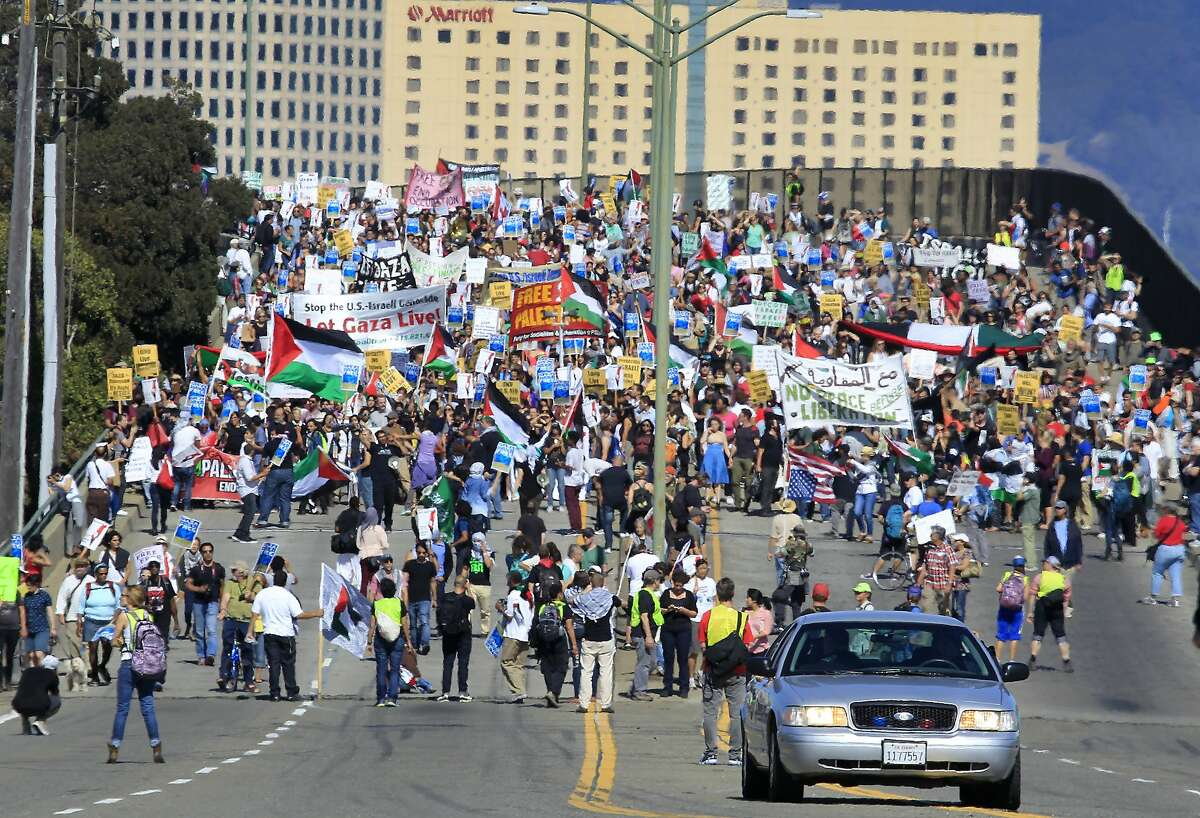 Thousands of pro-Palestinian protesters march towards the Port of Oakland to attempt a blockade of the Israeli cargo ship Zim, which was scheduled to dock at the port in Oakland, Calif. on Saturday, Aug. 16, 2014. As of late afternoon, hundreds of police officers were preventing the protesters from entering port property.