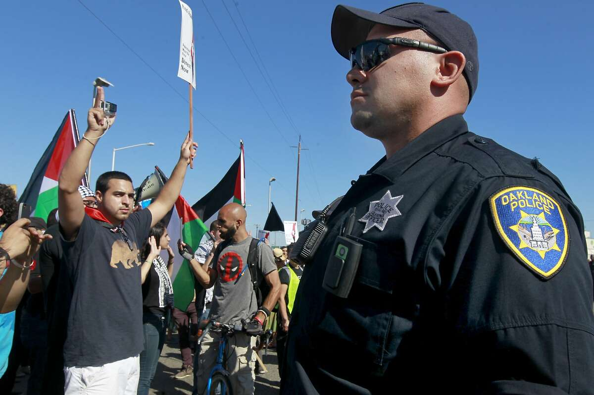 Police officers prevent thousands of pro-Palestinian protesters from entering the Port of Oakland to disrupt the unloading of the Israeli cargo ship Zim, which was scheduled to dock at the port in Oakland, Calif. on Saturday, Aug. 16, 2014.