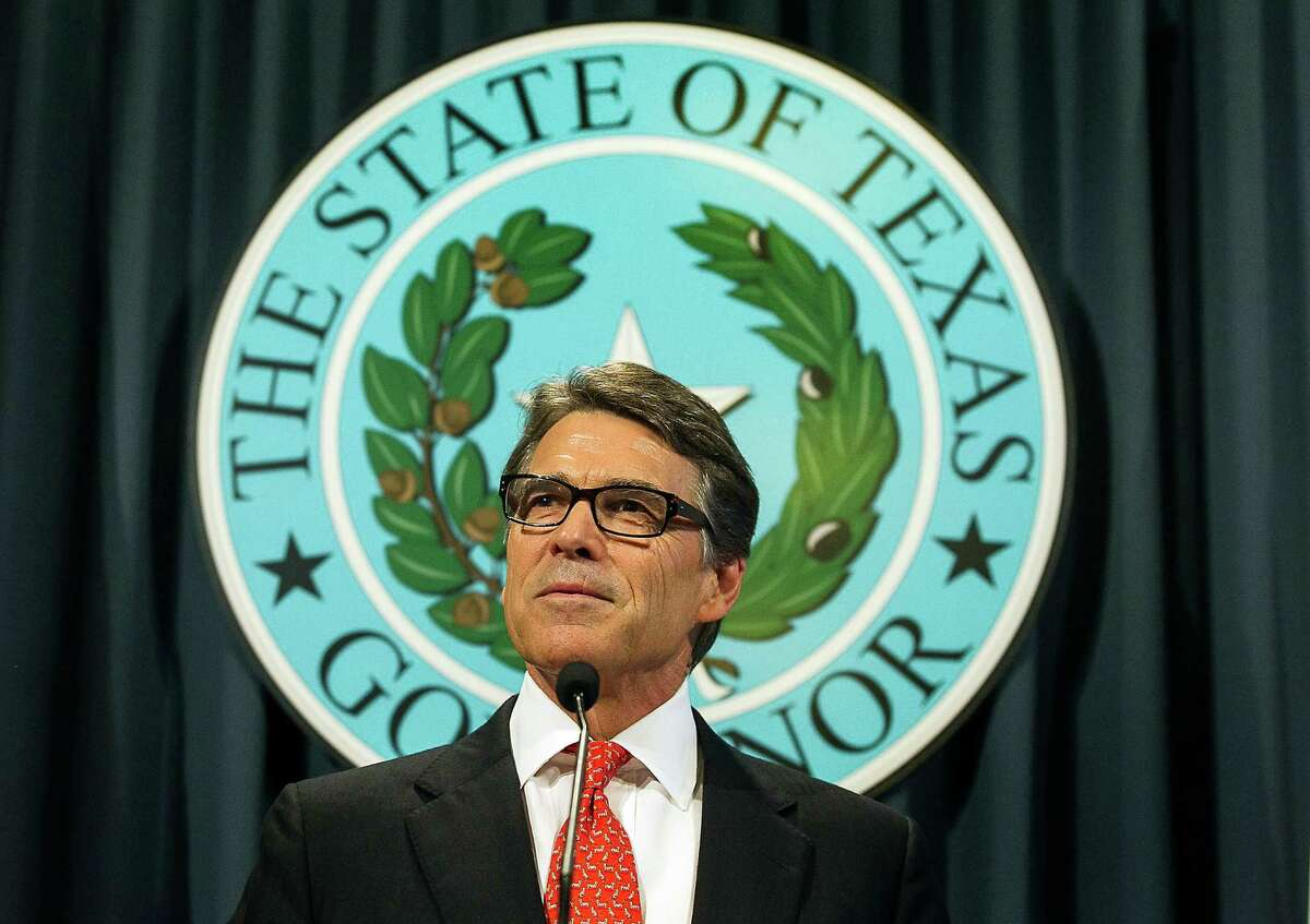 """Texas Gov. Rick Perry speaks during a news conference on Saturday, Aug. 16, 2014, in Austin, Texas. Perry said Saturday that the indictment against him was an """"outrageous"""" abuse of power and vowed to fight it."""