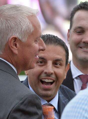 Owner Mike Repole, center and trainer Todd Pletcher, left are exuberant after his horse Stopchargingmaria won the 134th running of the The Alabama Saturday afternoon Aug. 16, 2014 at the Saratoga Race Course in Saratoga Springs, N.Y.   (Skip Dickstein/Times Union) Photo: SKIP DICKSTEIN