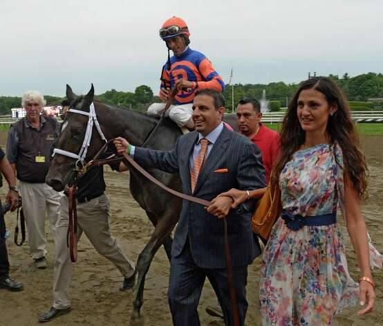 Stopchargingmaria with jockey John Velazquez aboard is lead to the winner's circle by owner Mike Repole and his wife Mari,  for whom the horse was named, after winning the 134th running of the The Alabama Saturday afternoon Aug. 16, 2014 at the Saratoga Race Course in Saratoga Springs, N.Y.   (Skip Dickstein/Times Union) Photo: SKIP DICKSTEIN