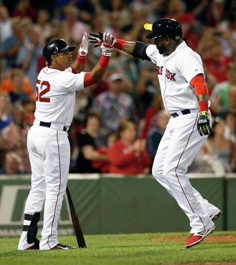 Boston's David Ortiz, right, is walking on air as he celebrates with Yoenis Cespedes after hitting a two-run homer in the third inning of Saturday night's 10-7 victory over the Astros at Fenway Park. Photo: Michael Dwyer, STF / AP