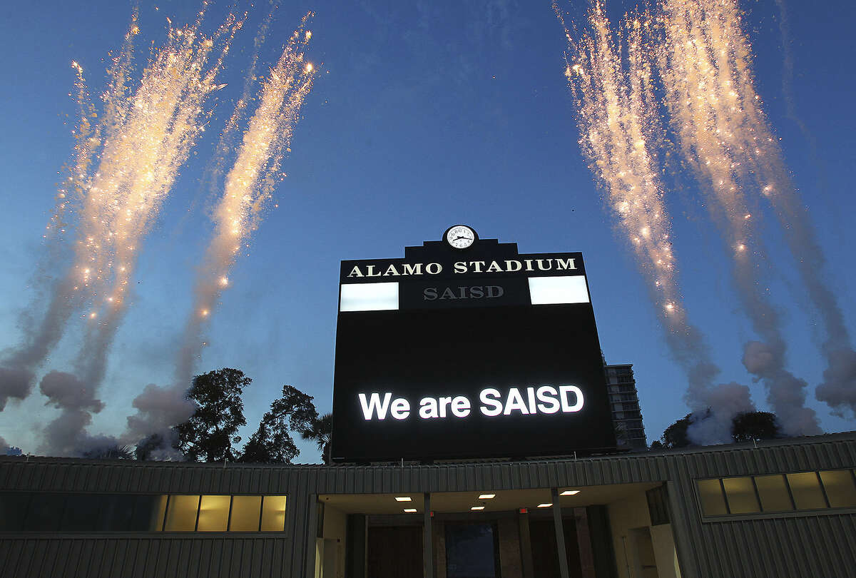 A fireworks display tops off the evening as SAISD officials rededicate the historic Alamo Stadium on Saturday, Aug. 16, 2014. The facility, affectionately known as the Rockpile, has been closed since 2013 for major renovation.