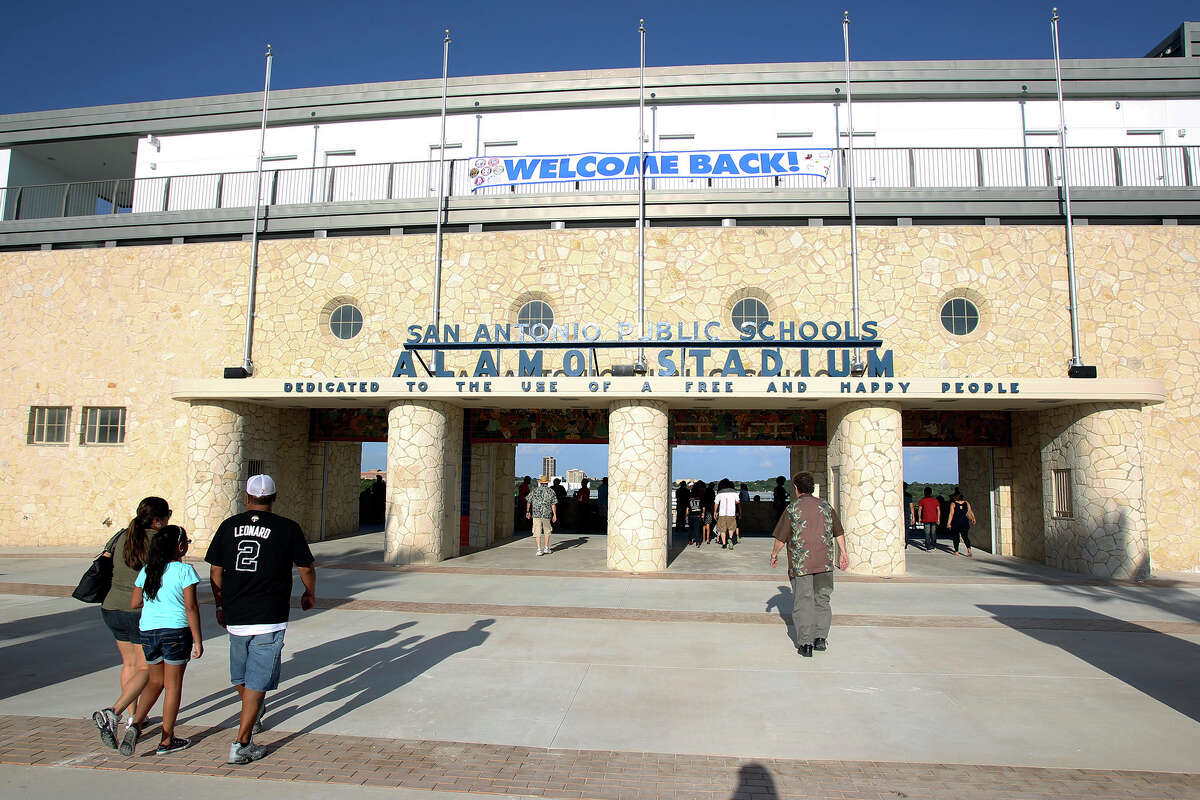 Spectators arrive as SAISD officials re-dedicate the historic Alamo Stadium on Saturday, Aug. 16, 2014. The facility has been closed since 2013 for major renovation.