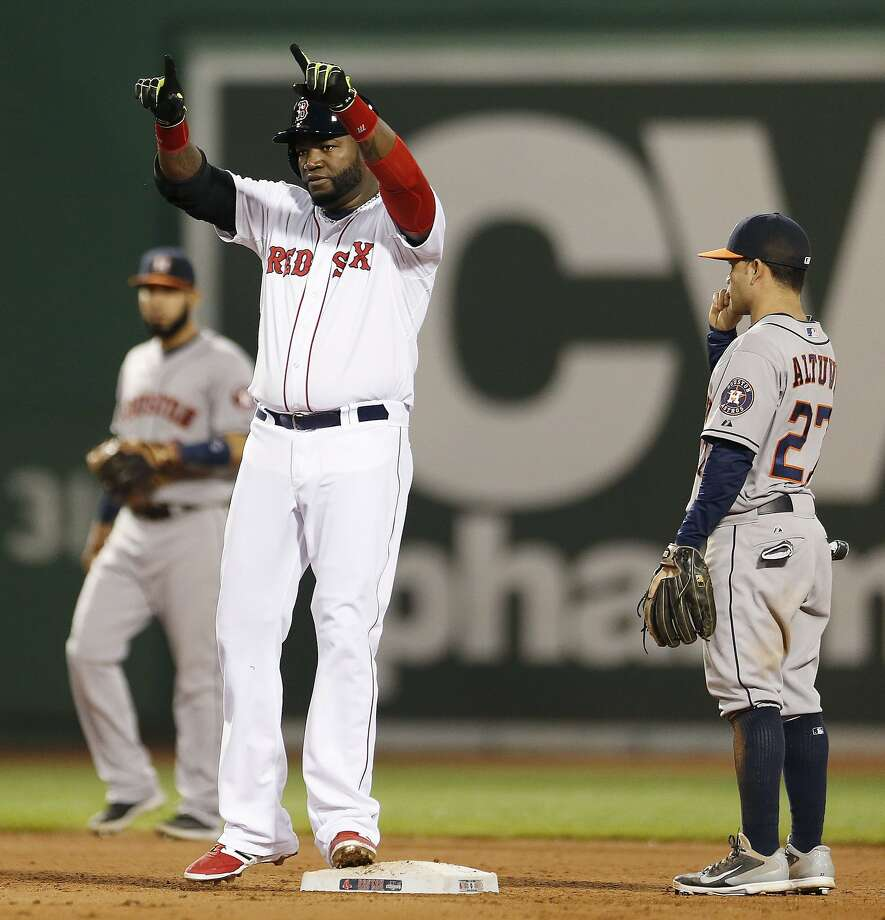 Boston Red Sox's David Ortiz reacts beside Houston Astros' Jose Altuve (27) after hitting a two-run double during the eighth inning of a baseball game in Boston, Saturday, Aug. 16, 2014. (AP Photo/Michael Dwyer) Photo: Michael Dwyer, Associated Press