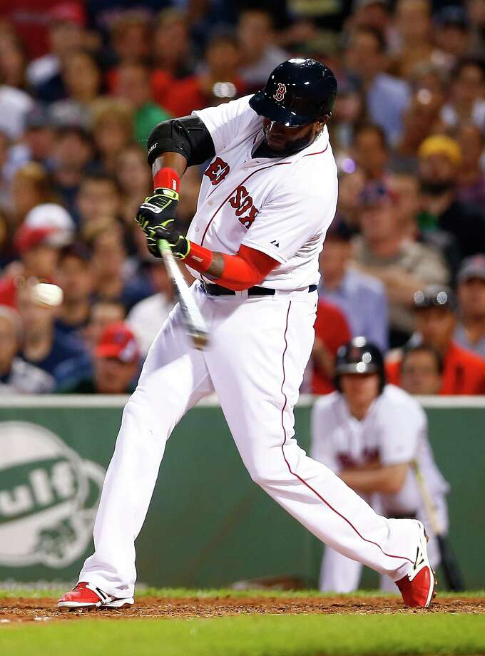 BOSTON, MA - AUGUST 16: David Ortiz #34 of the Boston Red Sox hits his second two-run home run of the game in the fifth inning against the Houston Astros during the game at Fenway Park on August 16, 2014 in Boston, Massachusetts.  (Photo by Jared Wickerham/Getty Images) ORG XMIT: 477588101 Photo: Jared Wickerham / 2014 Getty Images