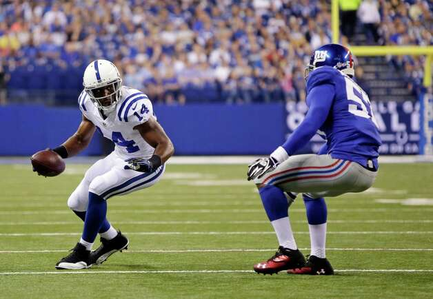 Indianapolis Colts' Hakeem Nicks (14) is defended by New York Giants' Jacquian Williams (57) during the first half of an NFL preseason football game Saturday, Aug. 16, 2014, in Indianapolis. (AP Photo/AJ Mast)  ORG XMIT: NAF110 Photo: AJ Mast / FR123854 AP