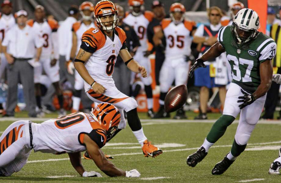 Cincinnati Bengals running back Cedric Peerman (30) fumbles the ball that was recovered by New York Jets free safety Jaiquawn Jarrett (37) in the second half of an NFL preseason football game, Saturday, Aug. 16, 2014, in Cincinnati. Quarterback Matt Scott (8) watches. (AP Photo/Tom Uhlman) ORG XMIT: PBS116 Photo: Tom Uhlman / FR31154 AP